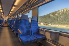 Train chairs and view through window Royalty Free Stock Images