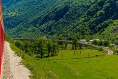 Train on the circular viaduct bridge near Brusio Royalty Free Stock Image