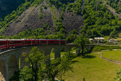 Train on the circular viaduct bridge near Brusio Stock Photos