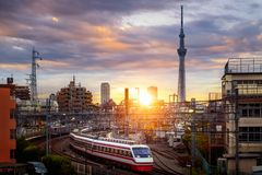 Train in city in Tokyo with sunset background royalty free stock image