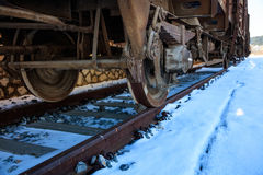 Train closeup on snowy railroad tracks Stock Images