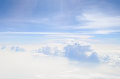 Train of clouds across a sea of mist Royalty Free Stock Image