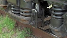 Train coach carriage wheels on rails runway. Dolly tracking close-up shot. Transportation concept stock video footage