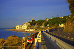 Train on coastal railway,Spain Royalty Free Stock Photography