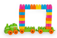 Train of colorful childrens building bricks with frame. Isolated on white background Stock Photo