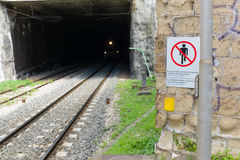 The train is coming. A city train coming out of a tunnel, Naples, Italy Royalty Free Stock Photo