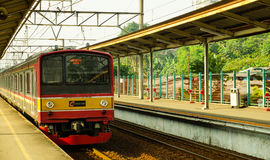 Train coming commuter line railway in station taken in depok indonesia Stock Images