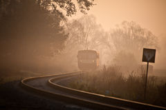 Train is coming. Local train coming to a small village station during a foggy morning Stock Photo