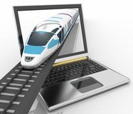 Train coming out of a laptop Royalty Free Stock Photo
