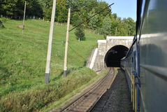 The train coming out of the tunnel. Travel by the train and looking out the train window you can see as train coming out of the tunnel Royalty Free Stock Photography