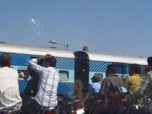 Train coming through the railway crossing in India stock video footage
