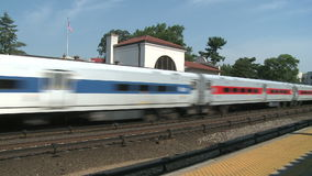 Train coming through small station. A view or scene from around town stock footage