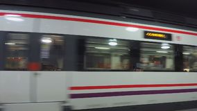 Train is coming into station. This is footage of an underground train station and how a train approaches it and drives away stock footage