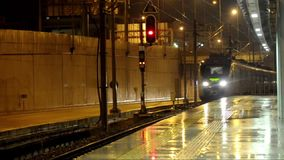 Train is coming. To the station under rain stock video footage