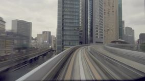 Train commuter running through the city. TOKYO, JAPAN - NOVEMBER 14, 2015 : Train commuter running through the city from Odaiba, Timelapse stock footage