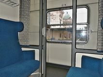Train compartment in blue at the station stock photography