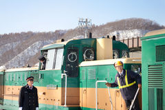 Train Conductor in Hokkaido, Japan. HOKKAIDO, JAPAN-1 FEB. 2013: Train Conductor in Hokkaido, Japan on Feb, 1, 2013, a snow day. Unidentified Japanese train Stock Image