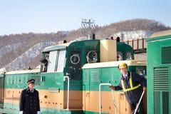 Train Conductor in Hokkaido, Japan. HOKKAIDO, JAPAN-1 FEB. 2013: Train Conductor in Hokkaido, Japan on Feb, 1, 2013, a snow day. Unidentified Japanese train Stock Photo