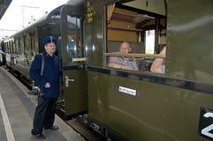 Train Conductor Waving on Train Royalty Free Stock Photo