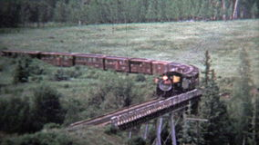 1972: Train cross a bridge and pov from inside coal powered engine. stock video footage