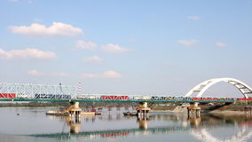 Train crosses the bridge. Industrial transport stock video