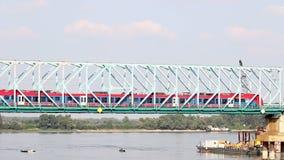 Train crosses the bridge. On the river stock footage