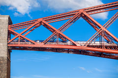Train crosses the Forth Railway Bridge in Edinburgh, Scotland Royalty Free Stock Photography