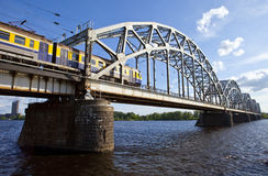Train Crosses the Iron Bridge over the Daugava River in Riga Royalty Free Stock Photos
