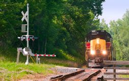 Train at crossing Stock Photos