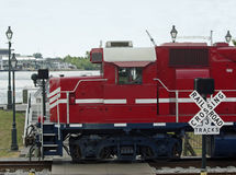 Train and crossing. Red freight train going through a railroad crossing Royalty Free Stock Photo