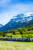 Train crossing Alps countryside Royalty Free Stock Images