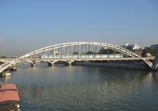 Train crossing bridge Stock Photo