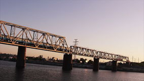 Train crossing bridge above the river. stock footage