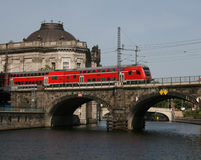 Train crossing bridge in Berlin Royalty Free Stock Image