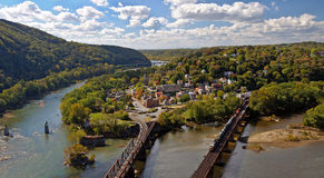 Train crossing bridge in Harpers Ferry Overlook Panorama Royalty Free Stock Photography