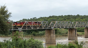 Train crossing bridge over elephant riverin south africa Royalty Free Stock Image
