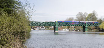 Train crossing bridge over Thames at Bourne End stock image