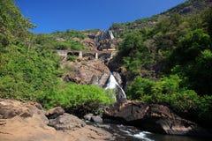 Train crossing Dudhsagar Falls Stock Images