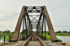 A train crossing the iron bridge. Somewhere in thailand Stock Photography