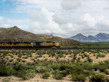 Train Crossing the Prairie in New Mexico USA Royalty Free Stock Images