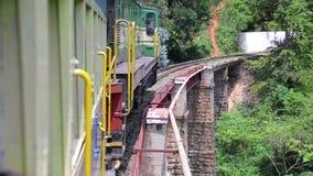 Train crossing railway bridge. Train cautiously crossing railway bridge stock video
