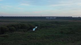 Train crossing a railway bridge in the distance, Trans-Siberian Railway. Full HD Resolution 1920x1080 Video Frame Rate 29.97 Length 0:47 stock footage