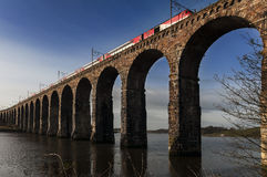 Train Crossing Stone Viaduct Over River. Train Crossing The Royal Bridge, a stone Viaduct over the River Tweed at Berwick-upon-Tweed Royalty Free Stock Photo