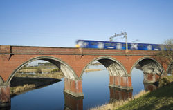 Train crossing viaduct Royalty Free Stock Photography
