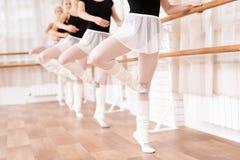 Girls ballet dancers rehearse in ballet class. stock photo