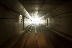 Train in the dark tunnel royalty free stock photography