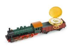Train de jouet avec la montre photos stock