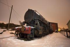 Train de vapeur dans la neige Images stock