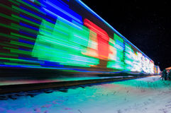 Train Decorated with Holiday Lights Arrives at Station Royalty Free Stock Image