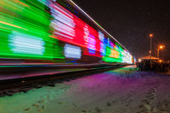 Train Decorated with Holiday Lights Arrives at Station Stock Photography